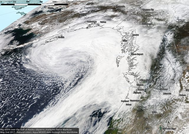 A storm over the Gulf of Alaska, Aqua MODIS imagery. QGIS was used to add the scale, borders/cities, and to reproject the image.