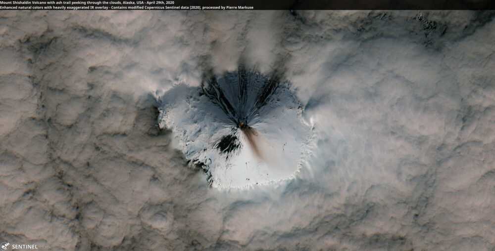 Mount Shishaldin Volcano with ash trail peeking through the clouds, Alaska, USA - April 29th, 2020 Copernicus/Pierre Markuse